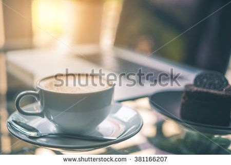 Latte coffee with laptop, coffee shop background, warm tone  - stock photo