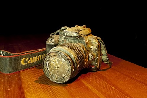 Found Canon 1000D on the ocean floor and returned the photos, still intact