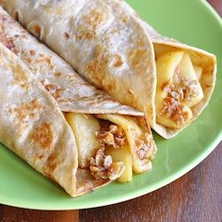 Cinnamon and nutmeg flavored whole wheat tortillas with apple and granola filling.