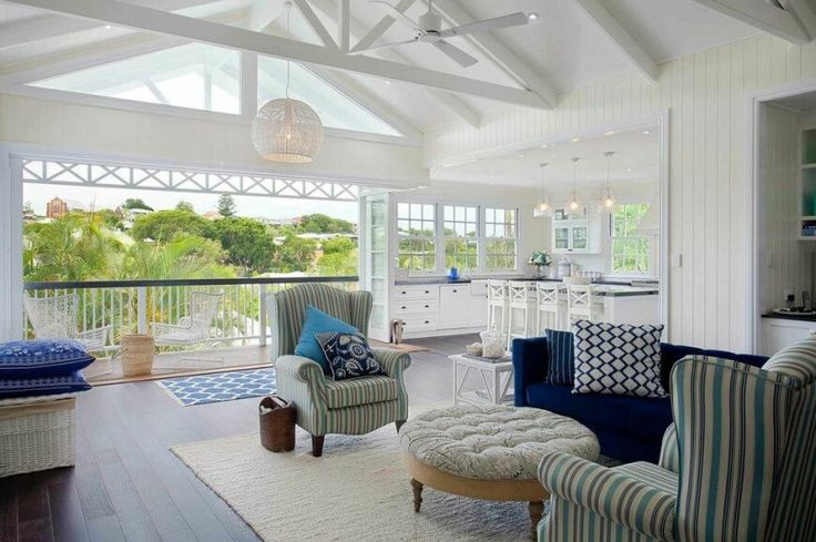 Light and airy hamptons queenslander fusion home for Queenslander living room ideas