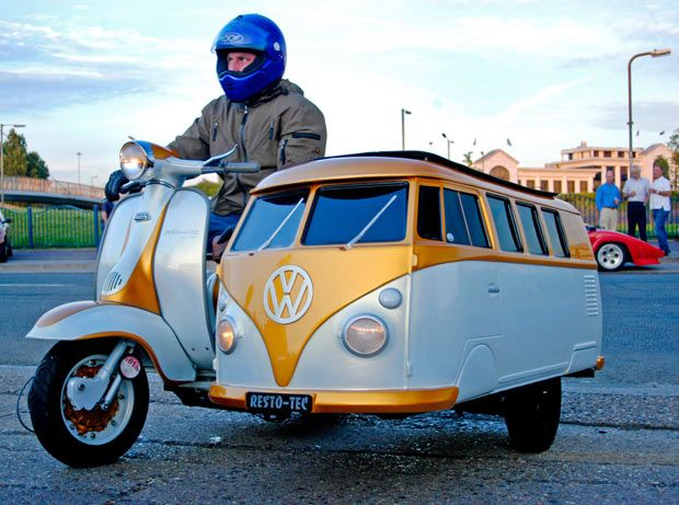 A Lambretta scooter with a custom-built VW campervan sidecar  in Northwood, Middlesex. The sidecar was created by scooter fan Jay Dyer for his 11-year-old son Kaine to sit in while they drive around the country. Jay spent seven months welding and painting the one-of-a-kind modification in his garden from a 'skin' he bought in Belgium.
