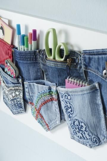 Cut out old jean pockets to hold crafting and office supplies. Read at : diyavdiy.blogspot.com