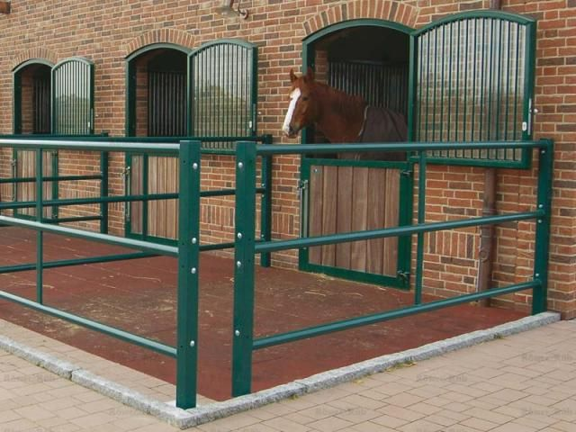 Small turnout pens with rubber floor and accessible gaps (for people, not horses)-love those gaps