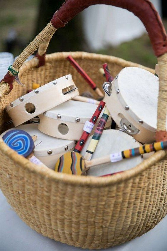 For a summer camp theme wedding fill a basket with small instruments for some fun campfire singing
