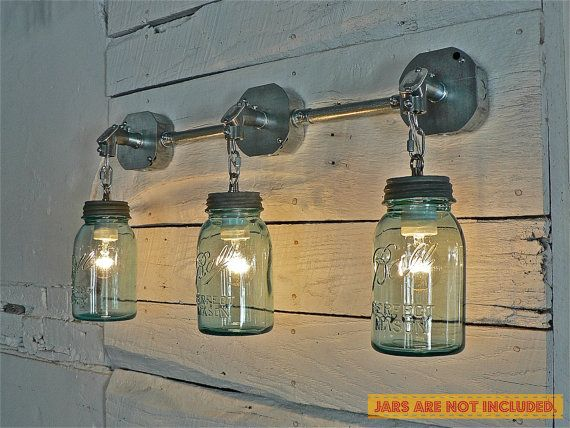 JARS ARE NOT INCLUDED. Ready for your small/regular mouth mason jars.    This hardwired fixture is handcrafted using antique zinc caps, galvanized