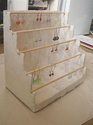 """I made this myself yesterday afternoon - I took a sturdy box & cut the sides like a staircase.  Then I paper machéd it.    The dowels are removable so the earrings can slide off (they can also slip on over the dowel).  Not sure if I should paint it now... I will add a ribbon around the bottom... I kind of like it """"rustic"""" but not sure.."""