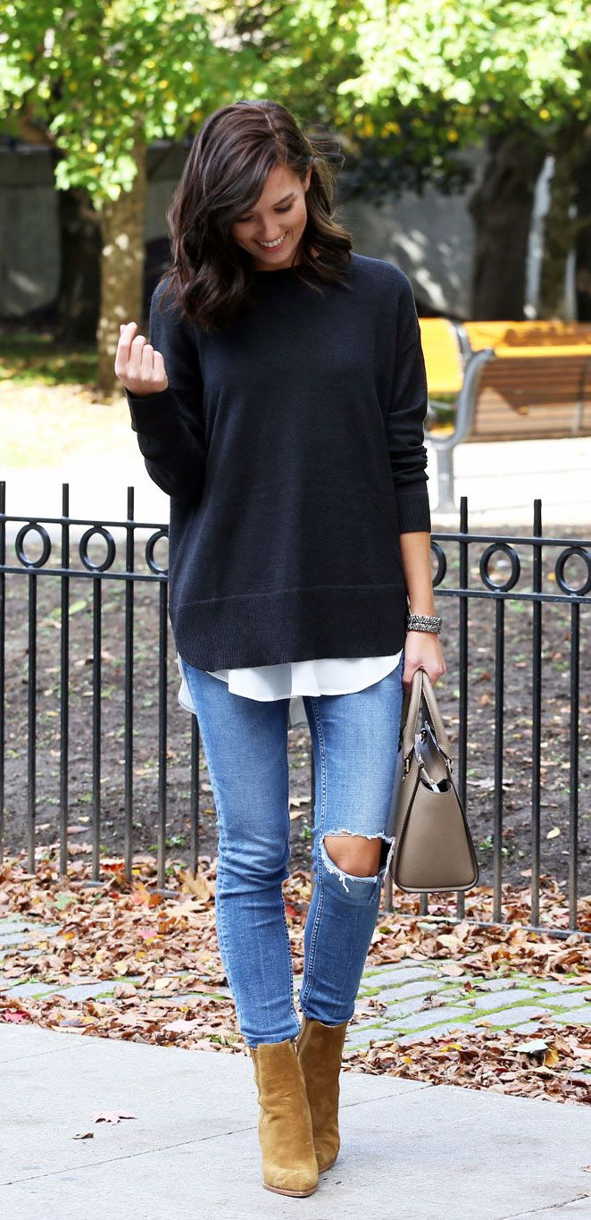 These jeans are an absolute favorite pair - SO flattering! And these booties go with everything from jeans to a dress! Fashion blogger Marie's Bazaar shows how to layer a large baggy sweater with ripped light wash denim and ankle boots by Marc Fisher