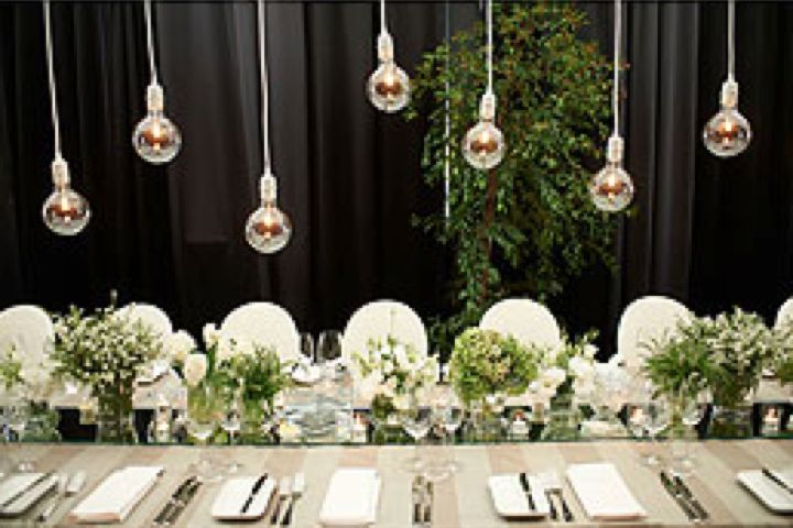 Hanging Light Installations over the long tables of our bridal couple Alexis & Travis