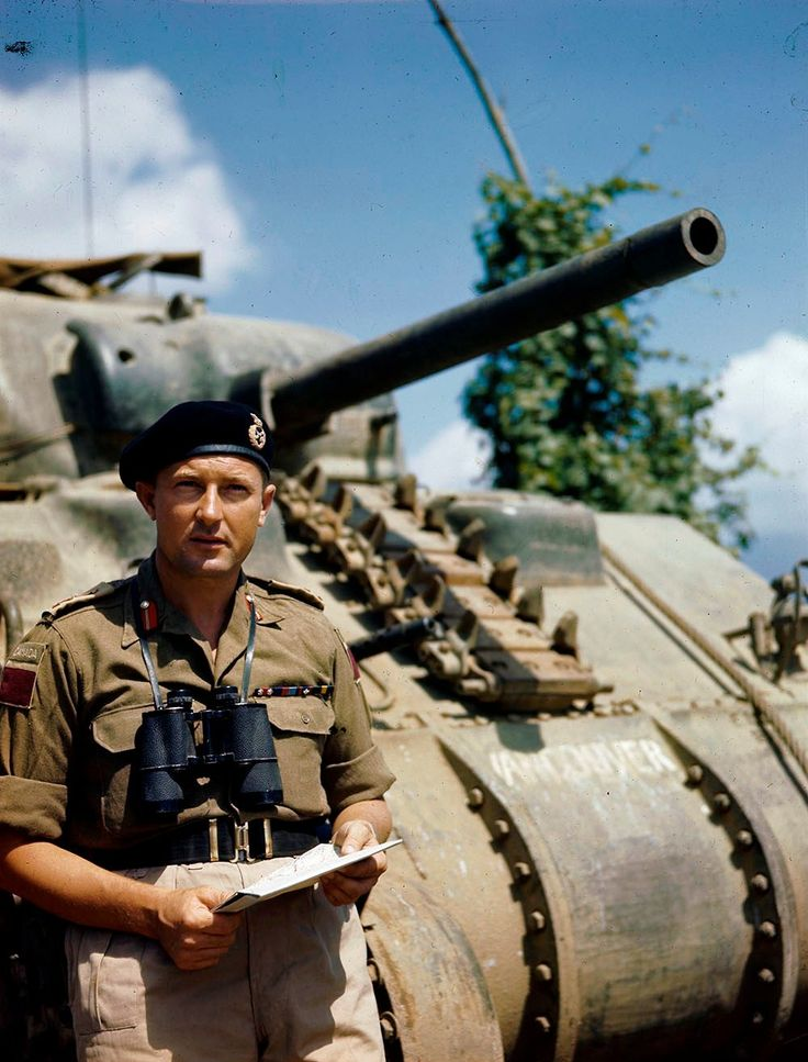 """The commander of the 5th canadian armored division, major-General Bert Hoffmeister at the tank M4 """"Sherman"""". The photo was taken in the period from March 1944 to June 1945."""