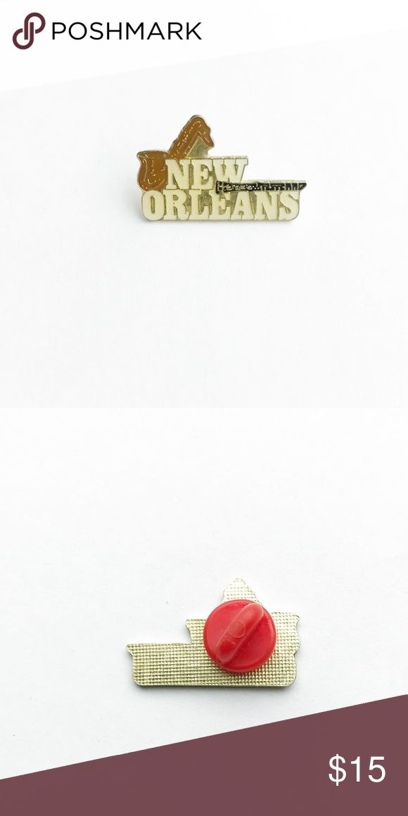 """Vintage New Orleans Enamel Pin Vintage New Orleans Enamel Pin  • true vintage • 1  1/8"""" x  3/4"""" • colors: red, blue, gold, yellow, orange, green, light blue, black • tags: French quarter, Louisiana state, love, saxophone, clarinet, state pride, buildings, houses, city, architecture, neighborhood, fun, hat, lapel, vest, brooch, jacket, jazz music, Marie gras, saints, parish, crescent city, big easy, beignets, Cafe du monde, canal street • all of the pins I sell are vintage & may contain minor…"""