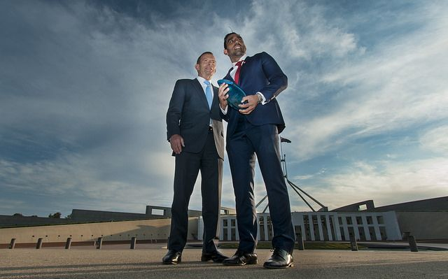 Adam Goodes & Prime Minister Tony Abbott Adam 8.1.1980 AFL player, Brownlow Medal 2003, 2006, premiers 2005, 2012, 4-time All-Australian, Indigenous Team of the Century, represent Australia in International Rules Series. Born South Australia, attended Merbein West Primary. He & his family moved to Horsham, played high school football, represent Victoria in U16 & U18. At 16 played with VFL Nth Ballarat Rebels in a premiership, joined the Sydney Swans in 1997, won 2014 Australian of the Year…