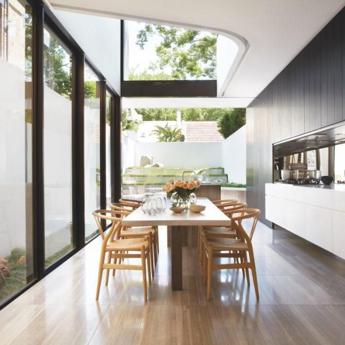 Walls of windows let in an abundance of light in this natural, alfresco kitchen.