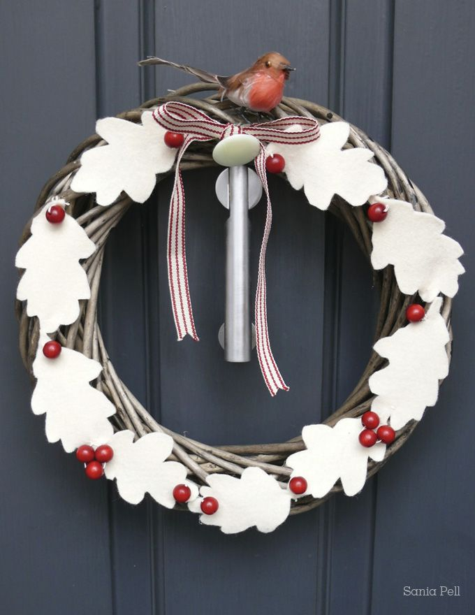 Wreath with white felt leaves and a bird