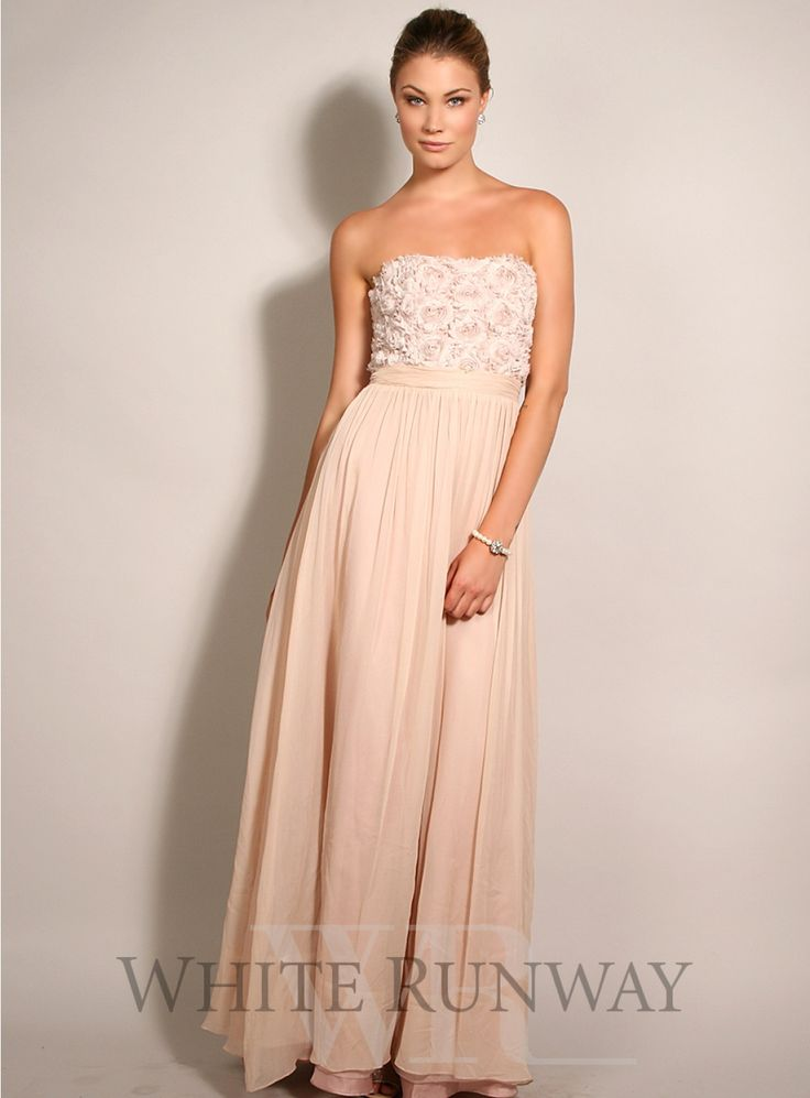 Silk Rosette Strapless Dress. A romantic and soft flowing dress suitable for brides, bridesmaids and black tie events by Australian designer Tania Olsen. A strapless style featuring silk rosettes on the bust and ruched detailing at the waist.