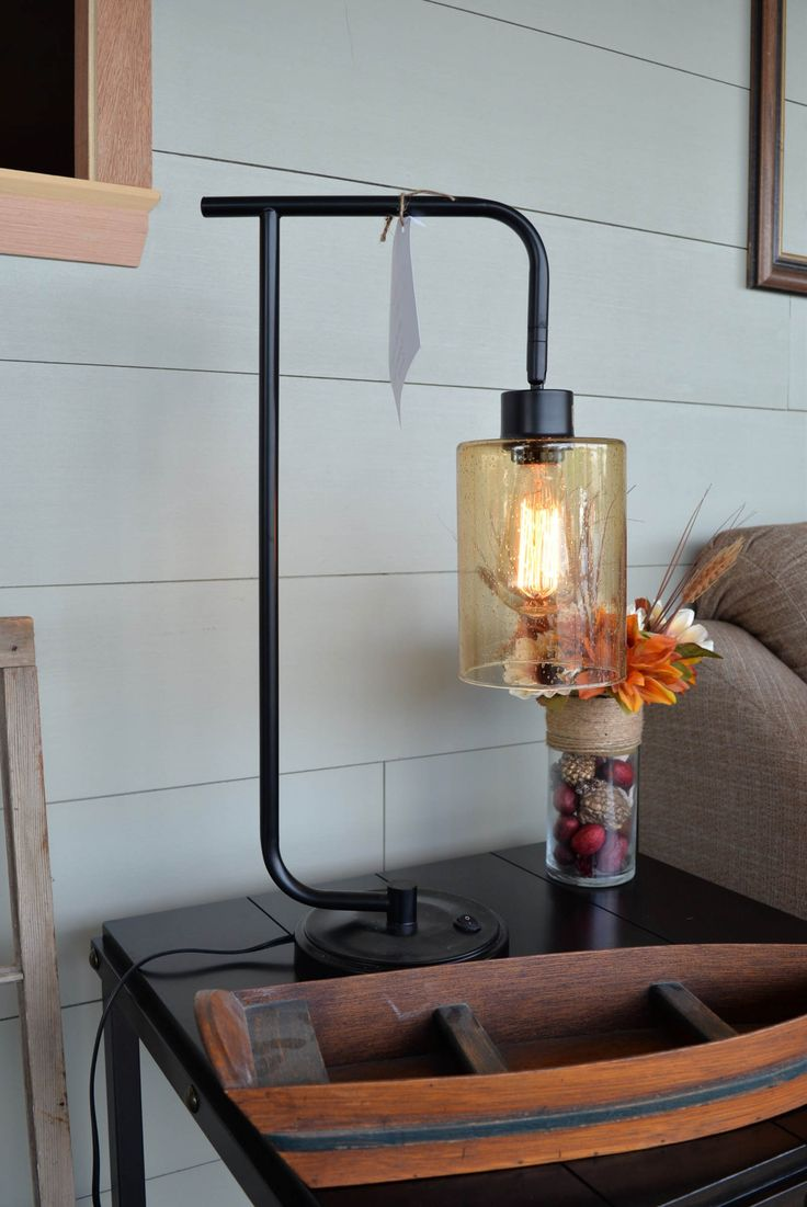This is by far the coolest lamp we've ever seen. It features an iron neck, push on/off switch, amber seeded glass, and an Edison bulb! Pair this with other industrial style decor or mix it up with something rustic!  TIP: Edison bulb lamps like this one put off a soft, warm light that looks so beautiful in front of an exposed brick wall. (The amber glass helps!)