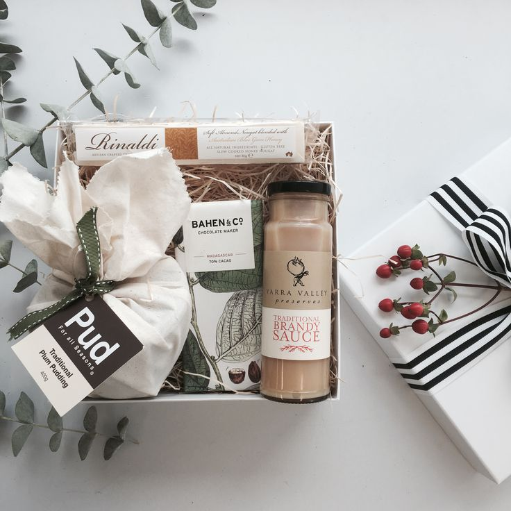 Christmas Gifts and Hamper ideas. Full of Christmas cheer this gift includes:  - Pud for All Seasons Traditional Pudding 400gm  - Yarra Valley Gourmet Foods Traditional Brandy Sauce  - Bahen & Co Gourmet Dark Chocolate  - Rinaldi Gourmet Soft Nougat  Packaged in an exclusive Gifting Co box with black & white stripped grosgrain ribbon & swing tag.