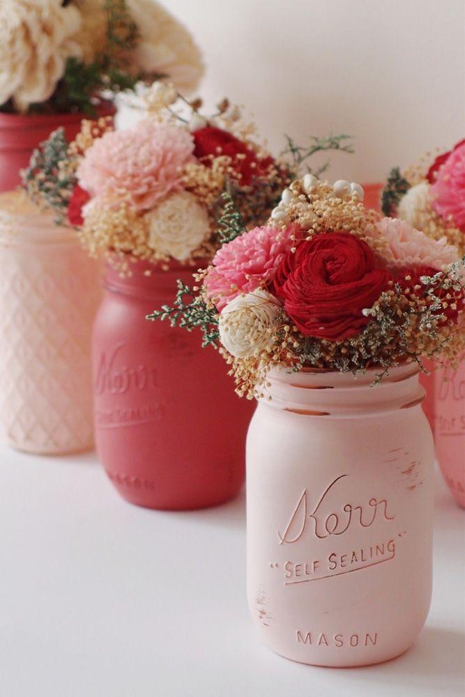 mason jars wedding centerpieces on wedding table rose jars with flowers beach blues