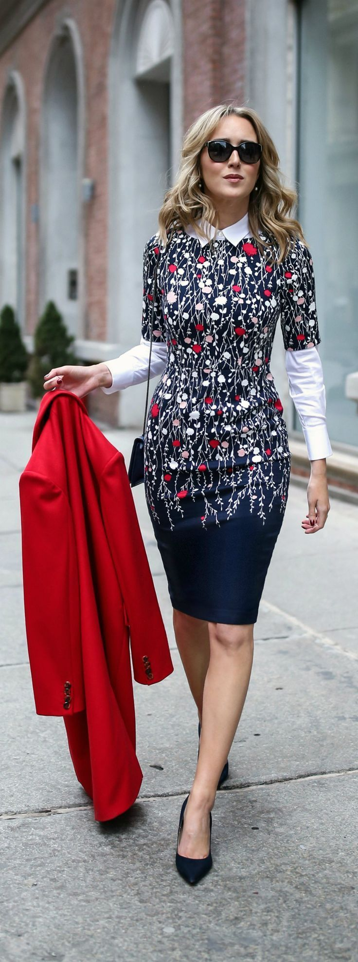 navy white red blush pink floral short sleeve sheath dress, layered white collared button down shirt, red wool coat, navy pointed toe pumps, classic workwear / office style