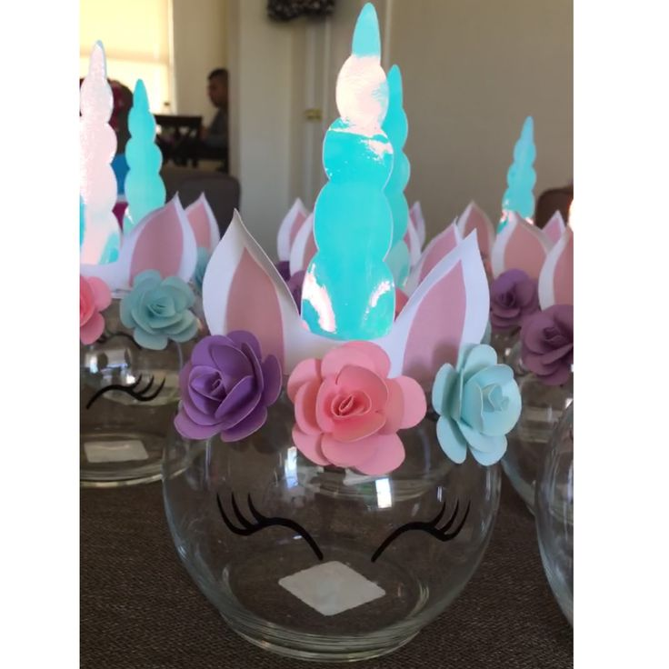 Made these super cute unicorn centerpiece for my daughters 3rd Birthday party! Made everything from cardstock paper. These were really fun to make! #Unicorn #unicornparty #centerpieces #paperflowers #unicornhorn