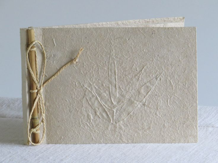 Barkpaper album with bamboo twig and leaves decorating.