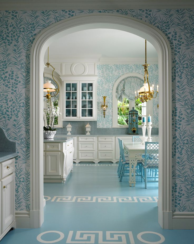 Blue and white, Greek key motif on floor, circle motif on floor and above window, arches. wall paper is a bit busy for me personally but this is a gorgeous space.