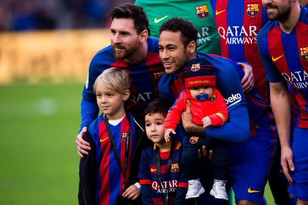 Lionel Messi and Neymar Santos Jr of FC Barcelona pose with son of Neymar Santos Jr Davi Lucca da Silva Santos (L) and other childrens before the La Liga match between FC Barcelona and Athletic Club at Camp Nou  stadium on February 4, 2017 in Barcelona, Catalonia.