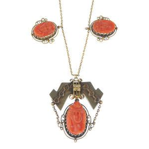 LOT:409 | A late 19th century gold coral pendant with later added early 20th century gold chain.