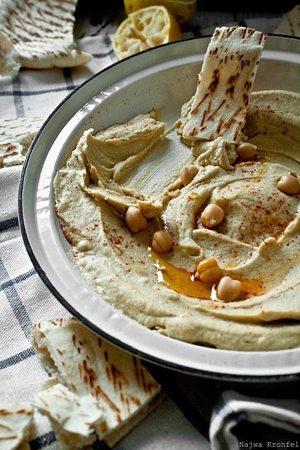 Hummus, This blogger's homemade hummus using the recipe from her childhood.  Ingredients: Canned Chickpeas, Tahini, Olive Oil, Garlic Cloves, Lemon Juice, Salt, Paprika. Food Processor.