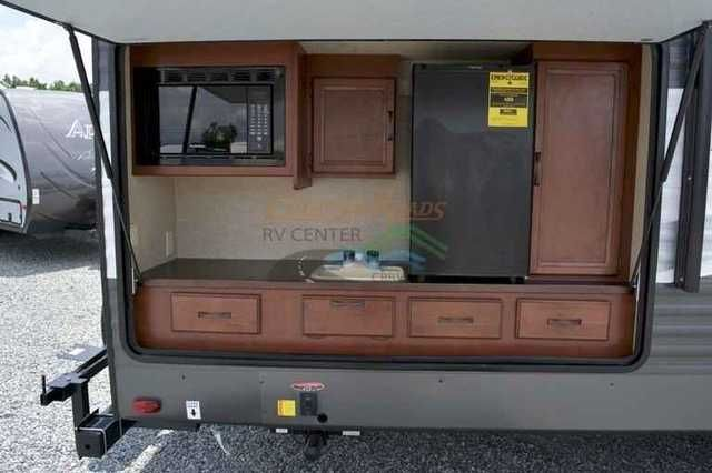 2016 New Palomino Puma 295BHSS Fifth Wheel in North Carolina NC.Recreational Vehicle, rv, 2016 Puma 295BHSS - Bunks, Outside Kitchen, If you like to cook outside for the kids, then this is the setup for you. This new plan incorporates an complete outside kitchen into a top-selling bunk floorplan for those that enjoy the outdoors. Great Puma quality with triple bunks and entry door in bunk room. U-shaped dinette for the times you want to eat inside. Flip around TV entertainment center with…