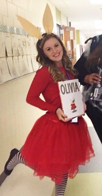 My Olivia costume for our Book Character parade! Cheap and easy to put together :)  - Black and white tights: $10 on Amazon - Red Cardigan: $18 at Target - Red tutu: borrowed from a friend - Black headband and Manila paper ears: handmade and 5 minutes to make with a hot glue gun!