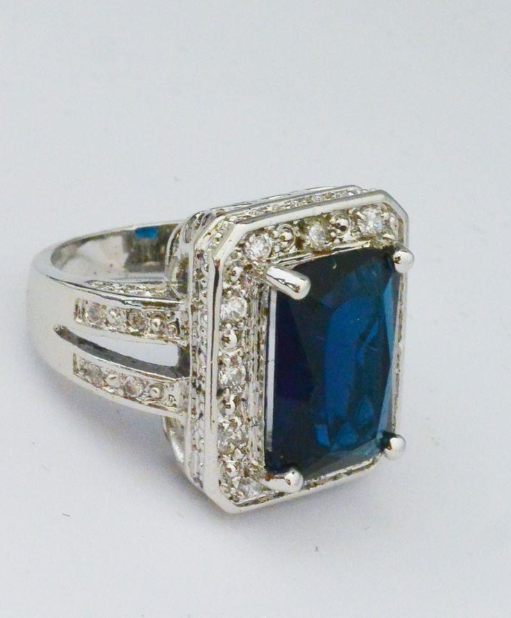 Large deep blue emerald-cut ring