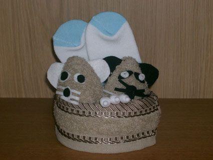 Baby cadeautje met muisjes van een washandje.