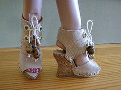 LOTS of tutorials for making all kinds of doll shoes! Checked it out, so cool. Now I have to try and make footwear. I always wondered what the heels were made of (I don't mean the ones in this pic). Now I know!