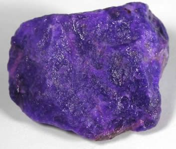 "Sugilite is named for the Japanese geologist who discovered the first specimens, Ken-ichi Sugi. It is opaque with a waxy luster and ranges  from a pale grayish lavender to a deep dark purple.   Sugilite is also known under the trade names of ""Royal Lavulite"" and ""Royal Azel""    Bright purple stones with little matrixing or blotches are the most valued. Gem grade sugilite is beautifully translucent and because it is quite rare it brings a high price."