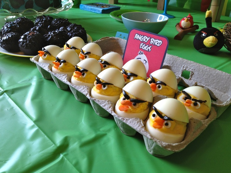 Angry Birds Devil'd Eggs.  Eyebrows-olives,  Beaks-baby carrot tips, Eye Whites-boiled egg whites punched out with drinking straw, Eyeballs-peppercorns