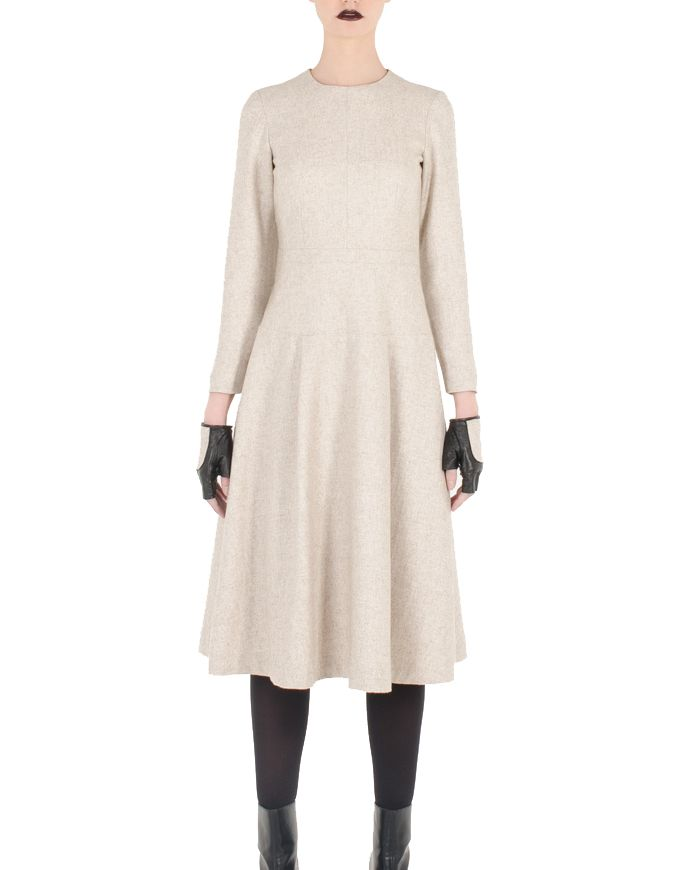 Light brown color short dress with semi-long sleeves by SHOPyte for women.  Model is 177 cm and is wearing size XS  Color: Light brown Fabric: 40% Wool, 40% Viscose, 20% Polyester Lining: 50% Viscose, 50% Polyester Measurements:  Care: Do not wash, no bleach product may be used; Dryclean, any solvent except trichloroethylene; Do not tumble dry Made in Spain  Conditions générales de vente