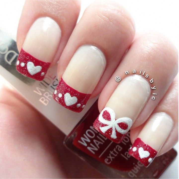 Red french tipped Christmas nail art with hearts and bows #festivemanicure...x
