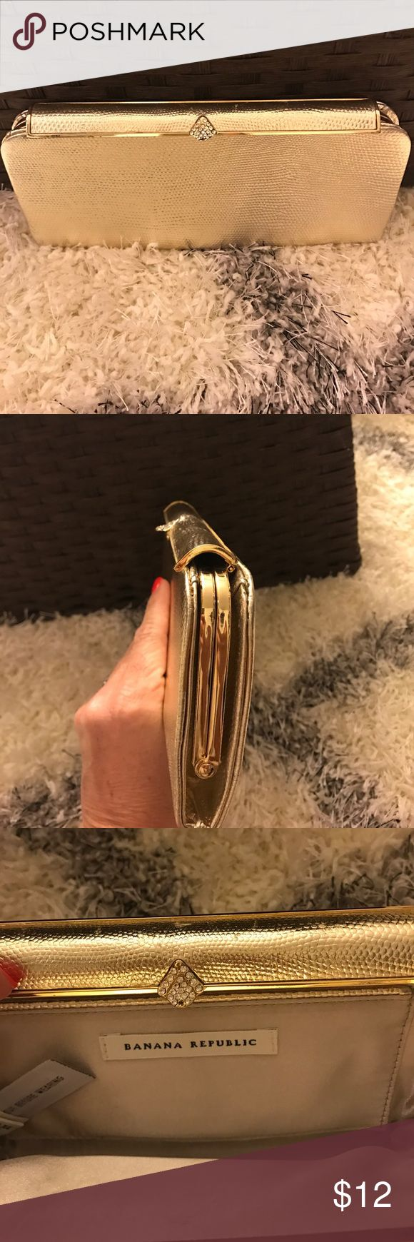 Banana Republic gold clutch Small clutch fits lipgloss, ids, credit cards and phone. (Holds nothing big and bulky) please see missing rhinestone stud on snap. Used once. Clean Banana Republic Bags Clutches & Wristlets