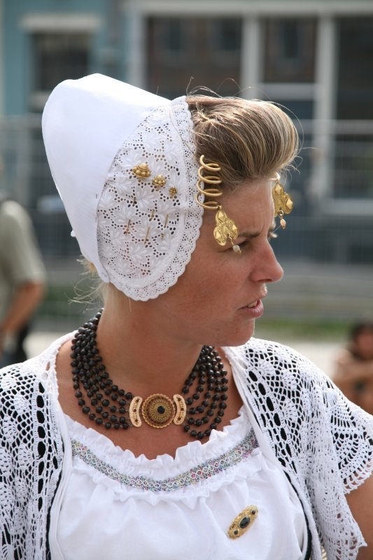 Europe | Portrait of a girl wearing traditional clothes and headdress, Walcheren, Zeeland, The Netherlands #lace #cap