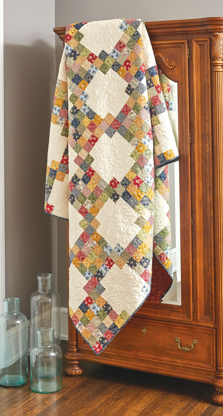 Irish quilts and Irish Chain quilt patterns are so much fun! A great collection of prints makes this scrappy-looking, generously sized, twin Irish quilt.