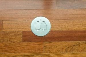 A floor outlet can provide power to objects in the middle of the room without having to cover wires to the wall outlets.