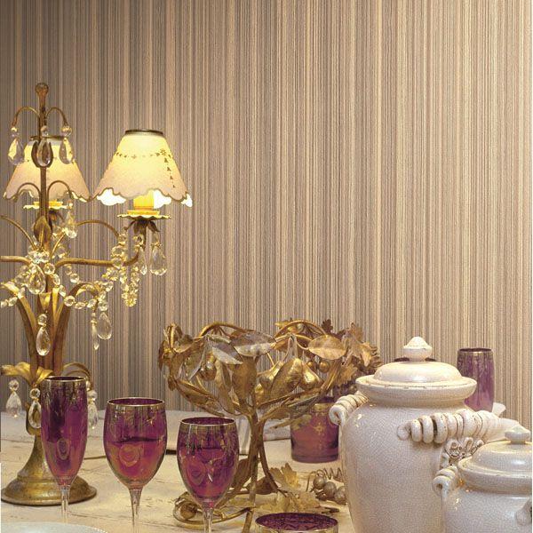 A romantic and luxurious tablescape decor idea mixing gold accessories with vintage purple wine glasses and a posh striped wallpaper 2537-M3950 Olive Satin Stripe - Donato - Beacon House Wallpaper