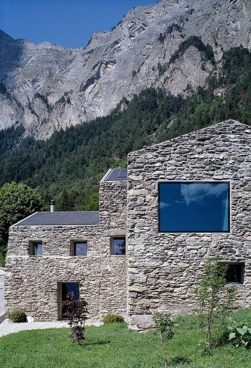 A rustic stone home in Chamoson, Switzerland | Redesigned by Savioz Fabrizzi Architectes.