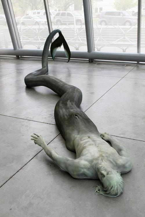 Anatomically correct sculpture of a merman. Beautiful, actually. Very well executed.