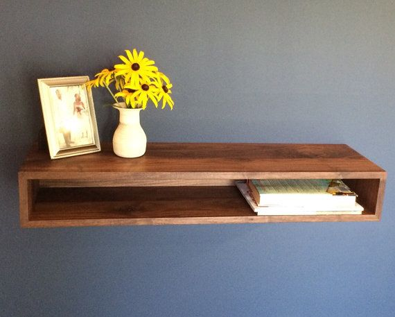 This Mid-Century Modern inspired floating table is the perfect display piece for an entryway, dining room or Bar. Also available at check-out in White
