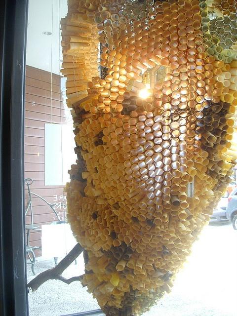 Amazing paper beehive chandelier at Anthropologie. #retail #merchandising #display #paper