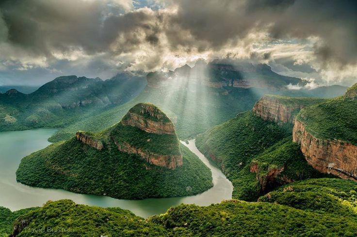 Blyde River Canyon, Mpumalanga, South Africa. The Blyde River Canyon, Mpumalanga, South Africa. The Three Rondavels are seen to the right of the center of this view. While it is difficult to compare canyons world-wide, Blyde River Canyon is one of the largest canyons on Earth, and it may be the largest 'green canyon' due to its lush subtropical foliage. It has some of the deepest precipitous cliffs of any canyon on the planet. It is known as one of the great wonders of nature on the…