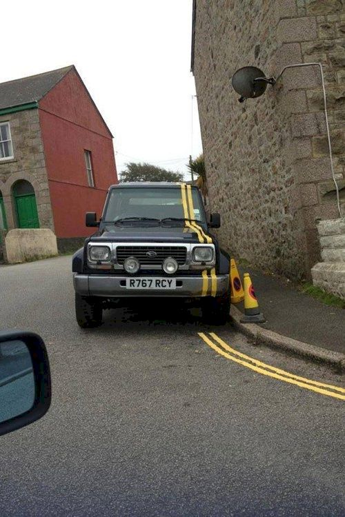 7. Nothing gets between this man and his double solid yellow line painting.