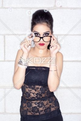 portrait of a elegant young woman with spectacles. - Portrait of a attractive…