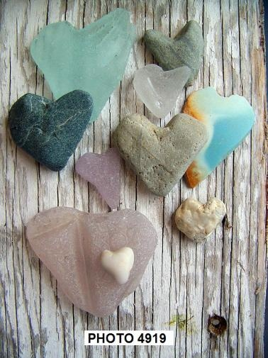 seaglass! I would love to add these to my collection! They are seaglass AND heart shaped for both my collections! Want!